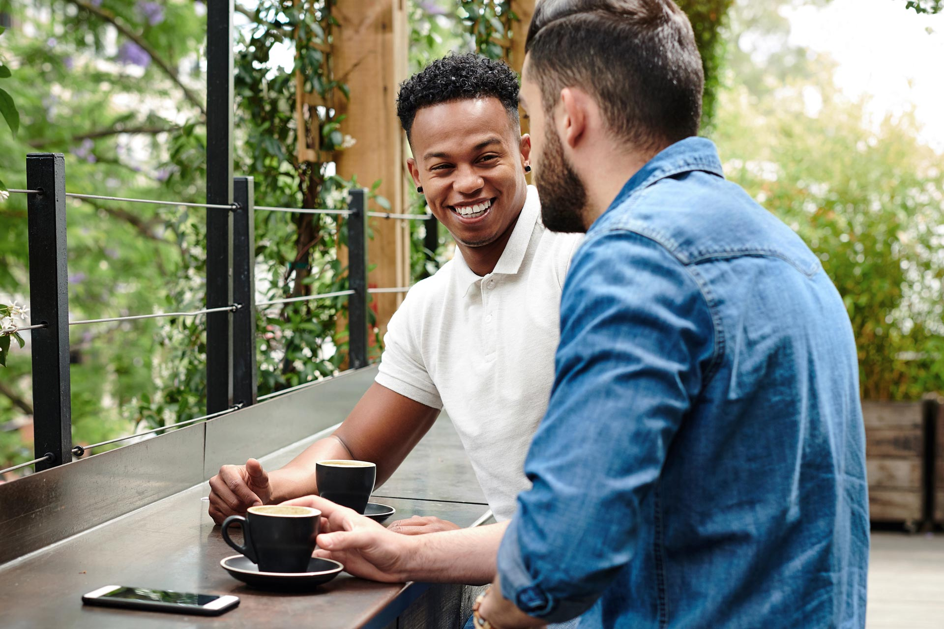 Two people sharing coffee and conversation
