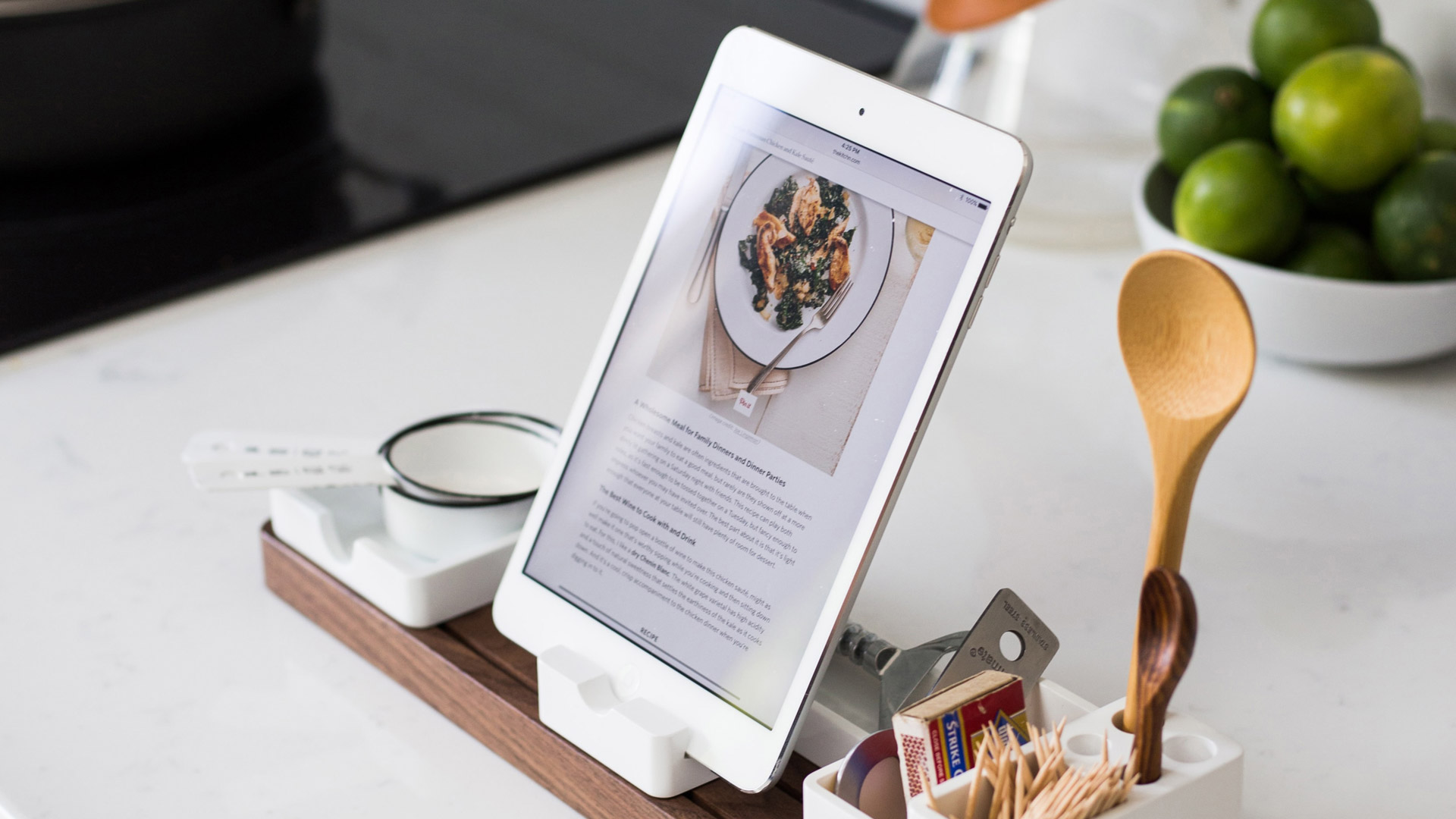 iPad showing recipe and cooking implements on kitchen counter