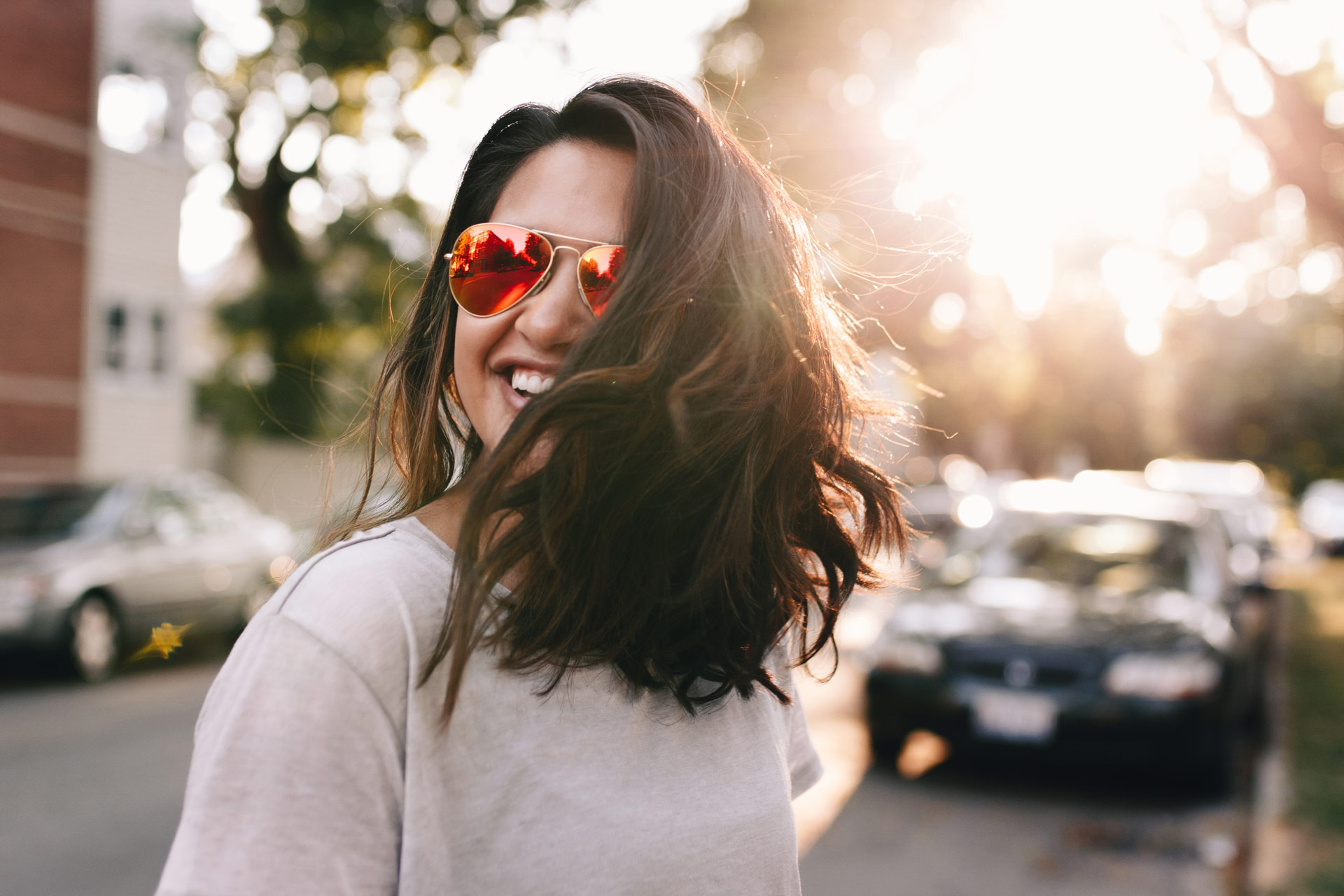 Woman with rose colored glasses in the fresh air