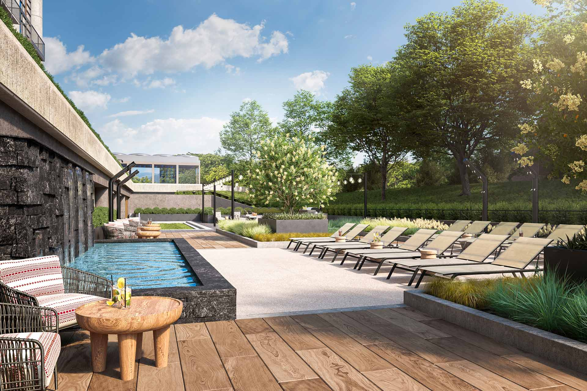 Patio with waterfall fountain and chaise lounges